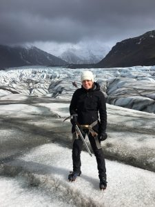 Conservation Biology Student Nicole Adrian -Photo of Nicole standing on a glacier in Iceland