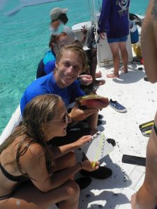 ConsBio student Molly Bidwell taking marine measurements at the Turks and Caicos School for Field Studies Program