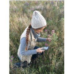 Maddy Kobs, Conservation Biology major in a prairie